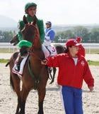 Before horse race. Before horse race,jockey M.Djanmurzaev,trainer R.Shamhalov.Hippodrome in city Pyatigorsk Royalty Free Stock Photography