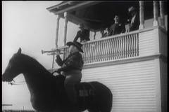 Horse race bugle call stock footage