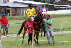 Horse race. Coaches prepare before attending a race horse in a field in Sukoharjo, Central Java, Indonesia royalty free stock photo