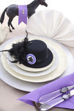 Horse Race Day Ladies Luncheon table setting. Horse racing Ladies Luncheon fine dining table setting with small black fascinator hat, decorations and champagne Royalty Free Stock Photos