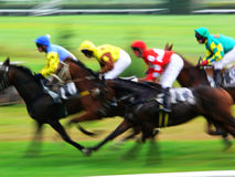 Horse race finish. Finish of a horse race with panning effect stock image