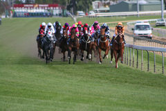 Horse race-motion. Melbourne cup Horse race front on Stock Image