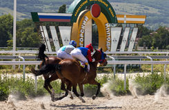 Horse race in Pyatigorsk. PYATIGORSK,RUSSIA - AUGUST 06,2017: Finish horse race for the traditional Prize in honor of the holiday of Akhalteke horse breeding Stock Image