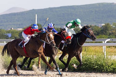 Horse race in Pyatigorsk. PYATIGORSK,RUSSIA - AUGUST 13,2017: Horse race for the traditional prize of Big Letni- the oldest and the largest racecourses in Russia Stock Photo