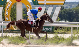 Horse race in Pyatigorsk. PYATIGORSK,RUSSIA - JULY 30,2017: Horse race for the traditional prize of  Terskogo zavoda - the oldest and the largest racecourses in Stock Photos