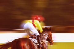 Horse race sprint. Rush for the victory in a horse race with motion blur effect Stock Photo
