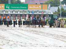 Horse race start. Louisville, KY – June 18: Stephen Foster Day at Churchill Downs horse race track June 18, 2011 in Louisville, KY. Start of The Chuck Evans Stock Photography