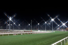 Horse Race Track. At night with turf and dirt track Stock Photo