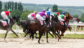 Horse racing. PYATIGORSK, RUSSIA - JULY 10: Unidentified riders at the start of a race for the prize of Kazanskogo ippodroma on July 10, 2011, in Pyatigorsk Stock Image