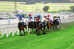 Horse racing. Typical horse race in Port Louis, every Saturday at the Champs de Mars, landmark race track in Mauritius with international jockeys participating Stock Photography
