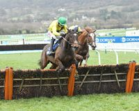 Horse Racing. Boyhood 1st near side and red rising 2nd far side seen here jumpin the last at cheltenham races 1-1-18 Stock Image