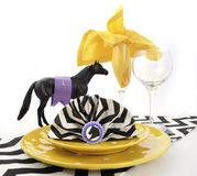 Horse racing carnival event luncheon table place setting. In purple, yellow theme, and black and white chevron strip table runner Stock Image