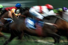 Horse racing effects. Horses race around the track during a horserace Stock Images