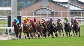 Horse racing in Hongkong jockey club Stock Images