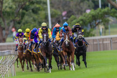 Horse Racing Jockeys Pacing Stock Photo
