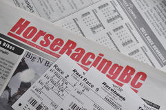 Horse racing newspaper and racing tickets background. COQUITLAM, BC, CANADA - May 8, 2014 : Horse racing newspaper and racing tickets background in Coquitlam BC Stock Image