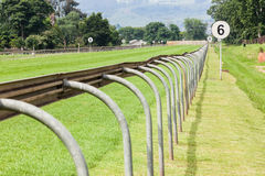 Horse Racing Track. Horse Racing Grass sprinters track straight down grass track with railing and distance signs Stock Image
