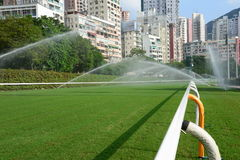 Horse racing track with sprinkling water. This is a horse racing track in Hong Kong Royalty Free Stock Photos