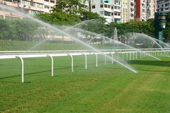 Horse racing track with sprinkler Royalty Free Stock Photos