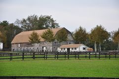 Horse Ranch Barn. An old barn for horses sits at the back of a fenced ranch in New Jersey, USA Stock Photos
