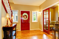 Horse ranch entryway with red door and hardwood floor. Royalty Free Stock Image