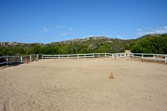 Horse rectangle of riding school. Surrounded by nature in Sardinia Stock Photos