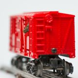 Horse in a red livestock train car from toy train - train on toy tracks stock photo