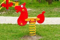 Horse. Red horse, outdoor toy - playground equipment Royalty Free Stock Image