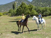 Horse ride. Mother and son riding on horseback Stock Photography