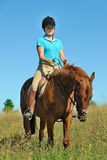 Horse Ride. Teenager taking a relaxing ride with her horse stock image
