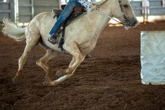 Horse And Rider Barrel Racing At A Rodeo. Close up of horse and rider barrel racing at a country rodeo in Australia royalty free stock photography