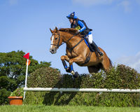 Horse rider competing in Cross Country Event. Horse rider competing in Cross Country and Showjumping Trials event at Kirkley Hall, Northumberland, England, UK stock photography