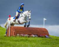 Horse rider competing in Cross Country Event. Horse rider competing in Cross Country and Showjumping Trials event at Kirkley Hall, Northumberland, England, UK stock photos