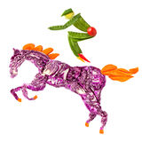Horse rider. A food concept of a horse rider made of fruits and vegs isolated on white Royalty Free Stock Photos