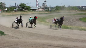 Horse and rider on a horse race at the track stock footage