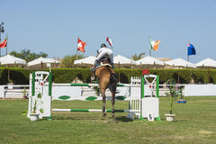 Horse and rider jumping in equestrian competition Royalty Free Stock Photos