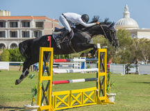 Horse and rider jumping in equestrian competition Stock Image