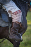 Horse rider leg boot saddle leather details closeup Royalty Free Stock Photos