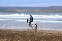 Horse and rider on the maharees beach Stock Photos