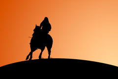 Horse and Rider - Silhouette. Silhouetted horse and rider against a sunset stock illustration