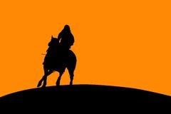 Horse and Rider Silhouette. Silhouette of a horse and rider going off into the sunset Royalty Free Stock Photos