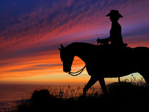 Horse and Rider Silhouette Sunset royalty free stock photography