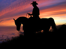 Horse and Rider Silhouette Sunset Royalty Free Stock Photos