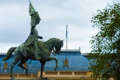 Horse and rider statue in a park with the sky in the background royalty free stock image