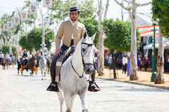 Horse rider taking a walk by the fair of Seville. Stock Image