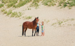 Horse with rider and two girls on the North Sea Texel beach Royalty Free Stock Images