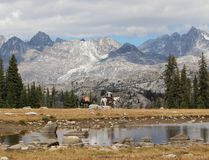 Horse Rider in Wind River Range. Mountain landscapes and wilderness adventures -- the Far West is very much alive in Wyoming`s Wind River Range. A horse rider Royalty Free Stock Photos