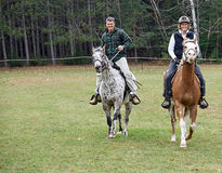 Horse Riders. Couple out riding horses on the farm Royalty Free Stock Image