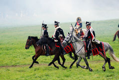 Horse riders at Borodino battle historical reenactment in Russia. BORODINO, MOSCOW REGION - SEPTEMBER 04, 2016: Reenactors dressed as Napoleonic war soldiers Stock Photography