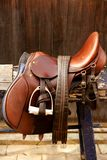 Horse riders complements, rigs, mounts. Leather over wood Stock Photography
